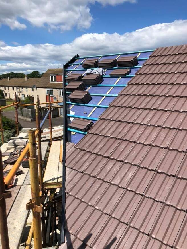 Tiles being laid on roof