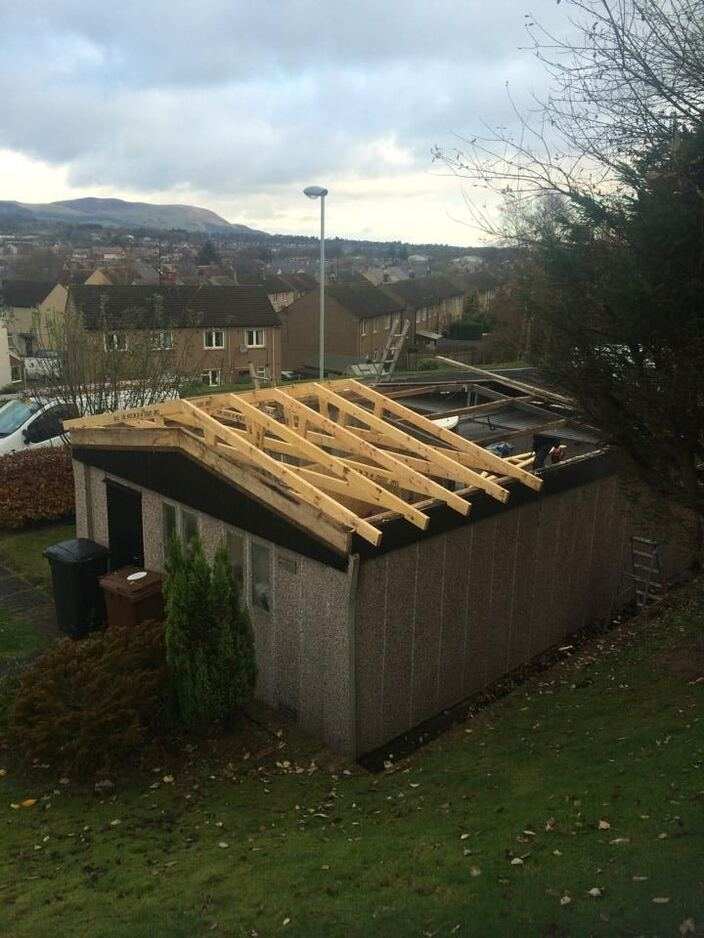 Roof being laid on outbuilding