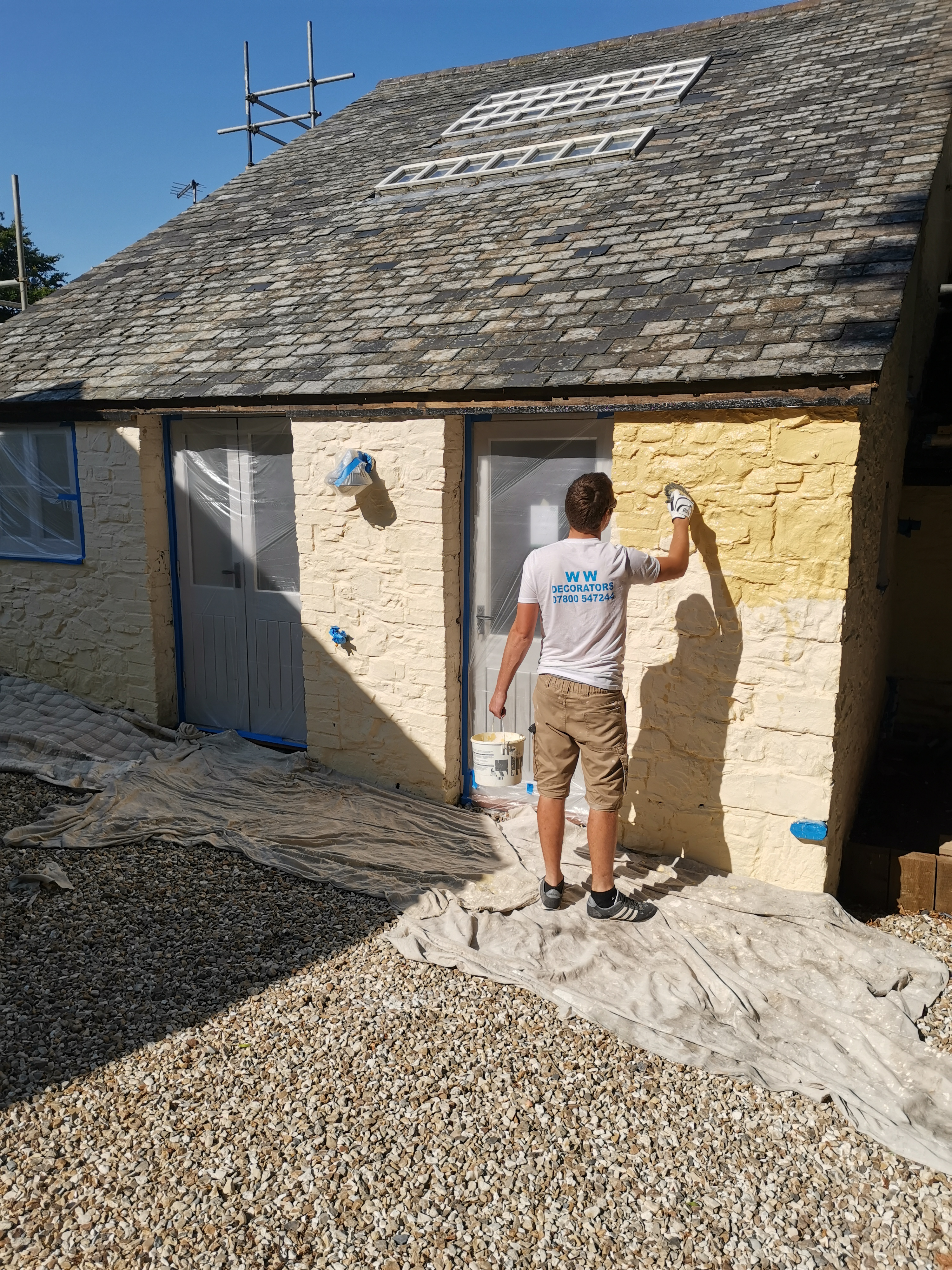 Outbuilding being painted